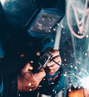 A welder is working, with sparks flying