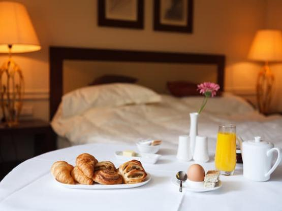 A continental breakfast laid out in a hotel or B&B bedroom