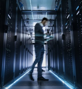 IT engineer examining server racks