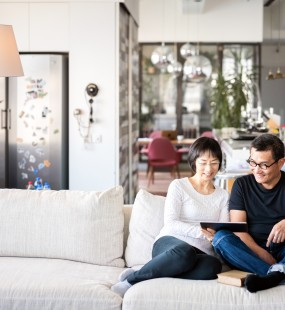 A cheerful couple relax in their large open-plan home