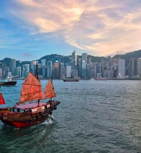Traditional junk boat sailing across Victoria Harbour