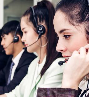 Call centre operatives wearing headphones