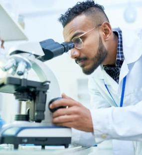 Doctor using microscope