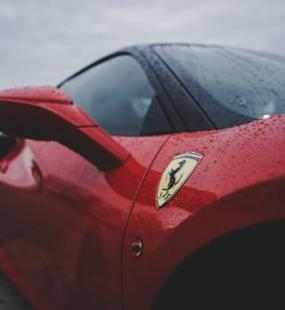 A red Ferrari in the rain