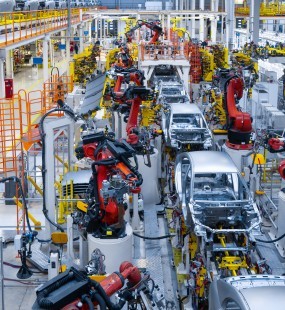 Partially-built cars on an automated production line