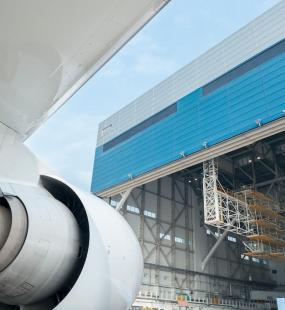 Plane engine coming out of hanger - Aviation and Aerospace Insurance - Howden Belgium