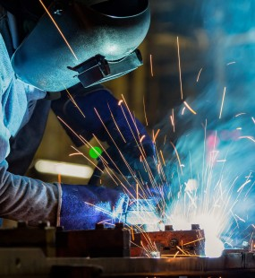 Image of someone crafting metal with sparks flying